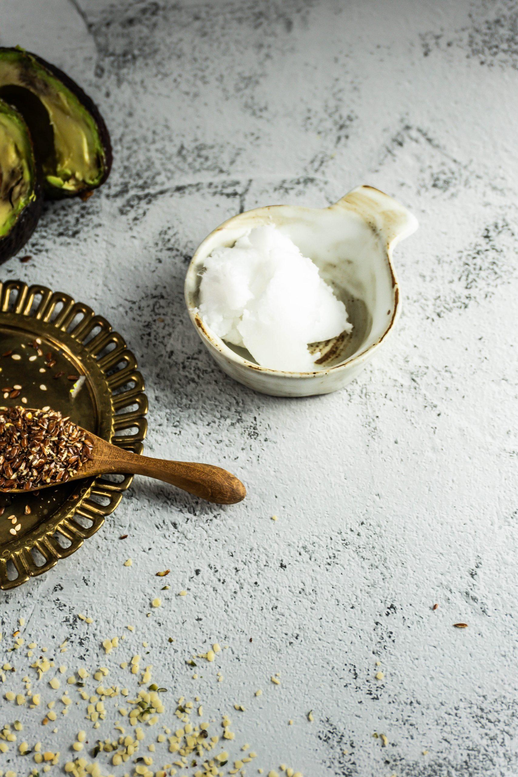 Coconut oil in a small white dish
