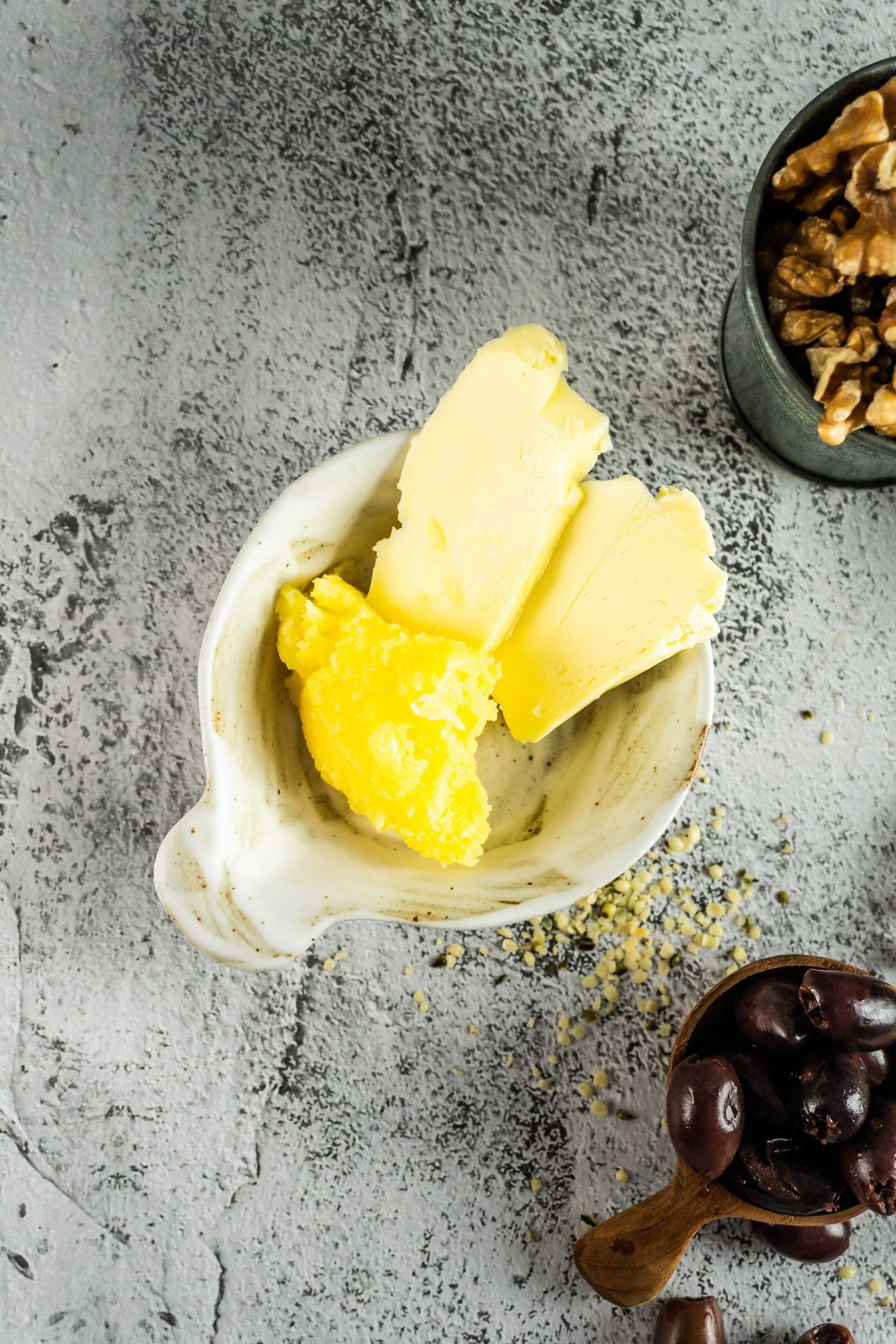 Butter and ghee in a small white dish photographed from above