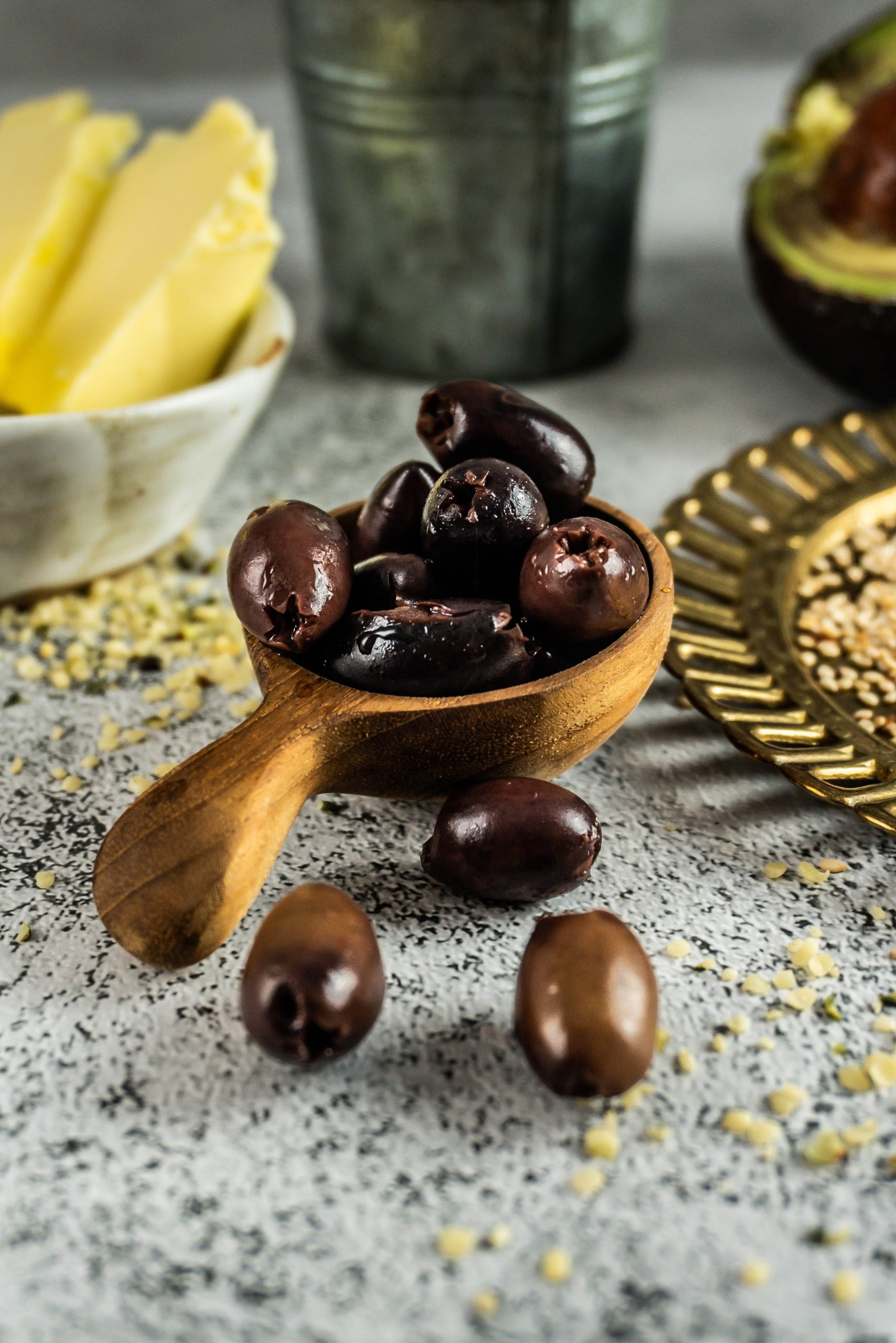 Olives stacked on a wooden spoon