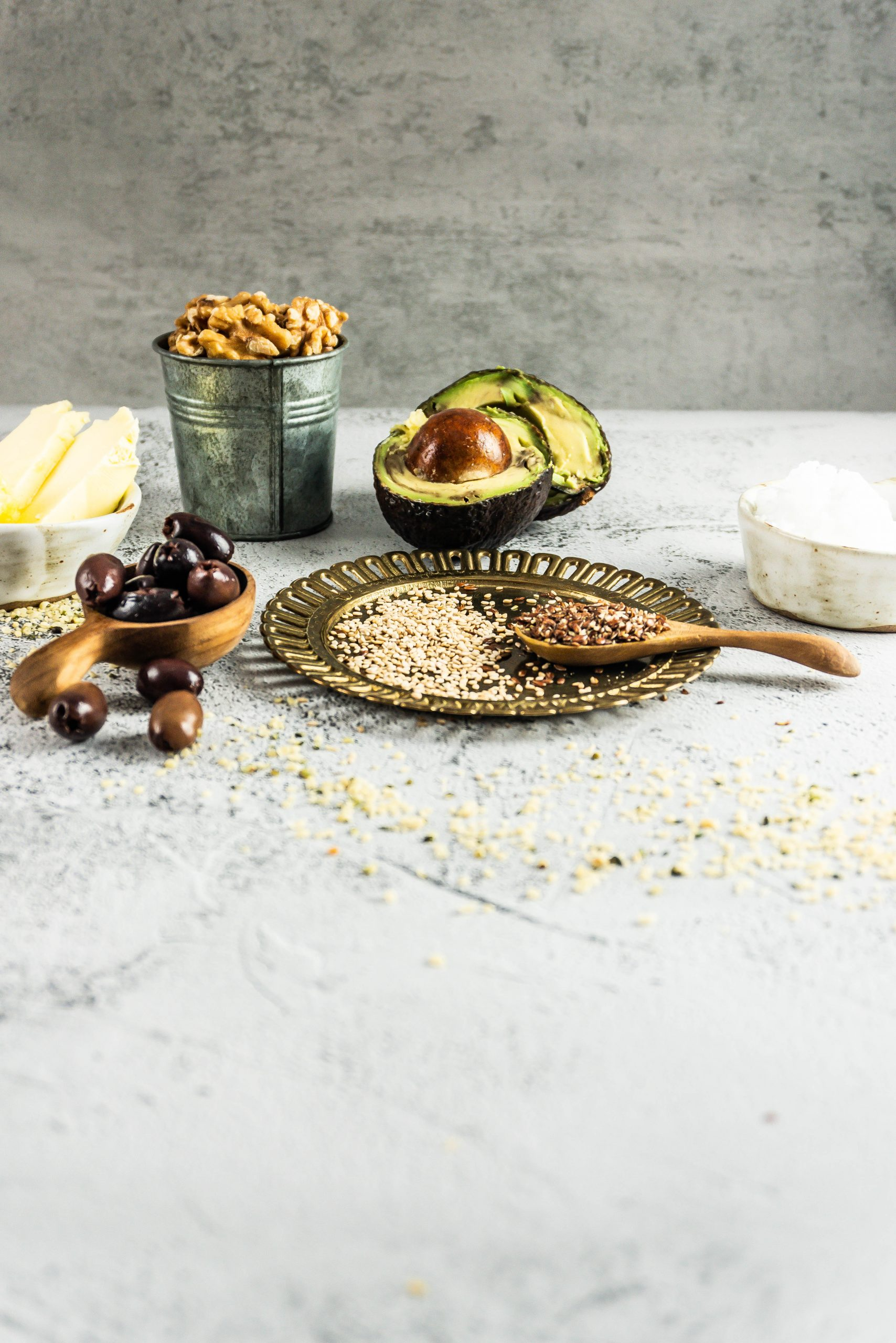 Different kinds of cooking oils on a concrete background