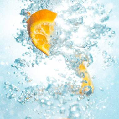 Orange slices in bubbling water