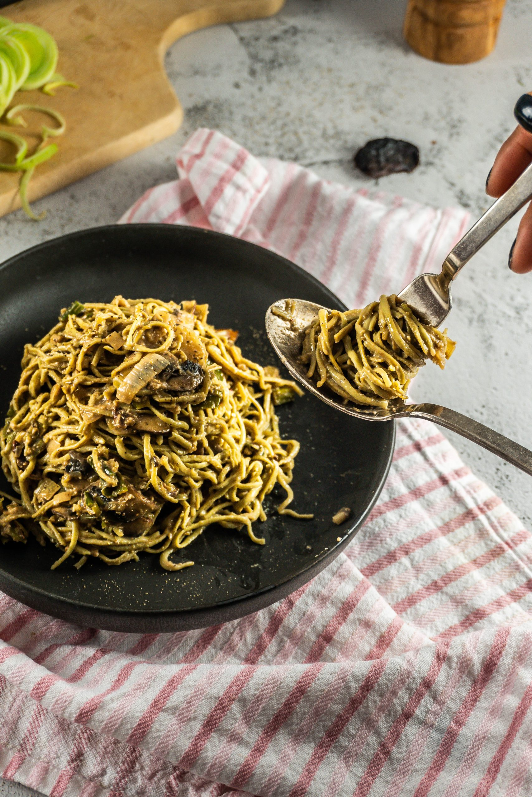 Creamy Mushroom and Leek Pasta being turned on a spoon